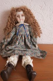 Puppe mit Porzellankopf Schlenkerpuppe genaues