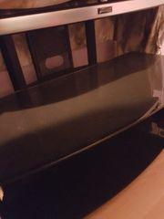 Brauner Fernseh Glas Tisch auf