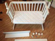 Baby-Beistellbett aus Holz weiß