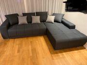 Couch Stoff grau
