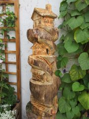 Feenhaus-Motorsägekunst-Skulptur-